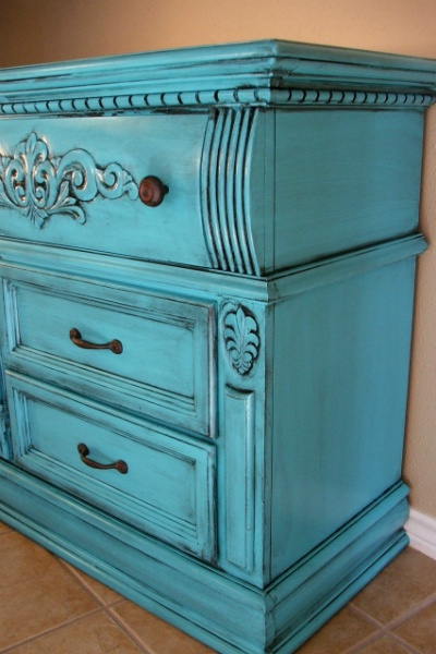 Dresser with molding and detailed scroll work, painted Turquoise and with Black