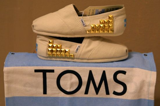 Studded TOMS shoes.