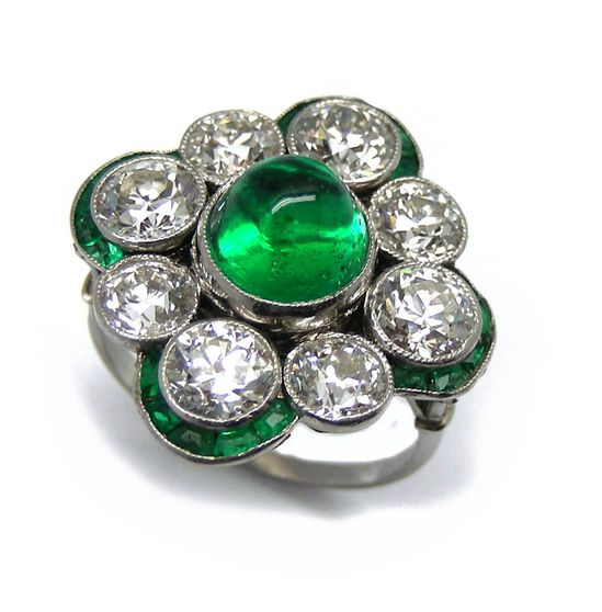 Early 20th century cabochon emerald and diamond cluster ring. S.J. Phillips Ltd.