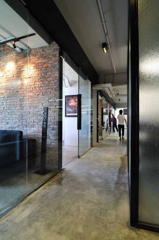 Studio Park has the same glass, transparent  walls with the open hallways! Go to www.modernrecycle... to find a great office space for you. Cool Raw Office Design > Hallway