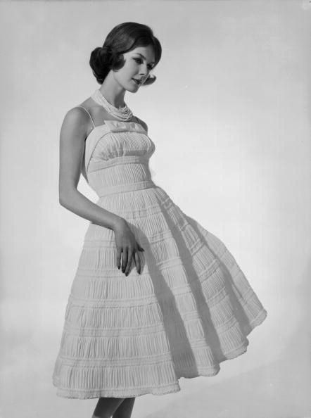 Model wearing a ruched, fitted evening/party dress, March 1959. #vintage #1950s #fashion #dresses