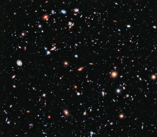 hubble extreme deep-field view looks back billions of years to capture ancient light, jeweled galaxies in the black velvet matrix of space and time.