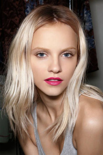 A matte finish on a fuchsia lip is a fresh look for spring