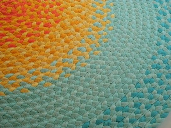 Gorgeous rug made from t-shirt yarn, braided and sewn together with a zigzag stitch