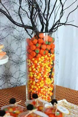 ? Halloween : centerpiece (fill vase with candy  (for plants that need water, set them in a thinner vase in the middle of the big vase and fill the space between with candy)