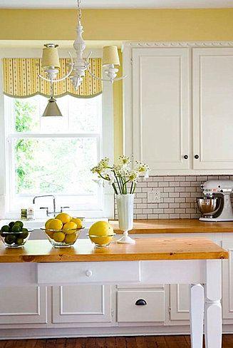 White and yellow kitchen.