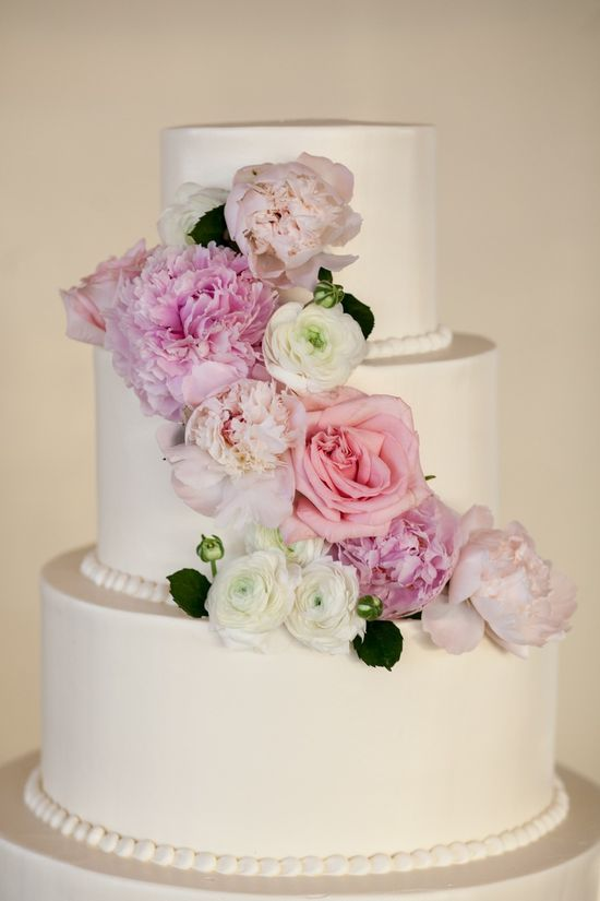 Simple #white #cake with stunning #flowers! Photography: Tanya Salazar of Craig Paulson Photography - www.cpaulson.com  Read More: stylemepretty.com...