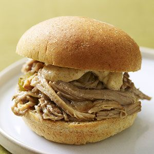 These Cajun-spiced sandwiches make a great game-day snack. Make this mouthwatering pork recipe overnight in your slow cooker to reduce preparation time the next day/dcc