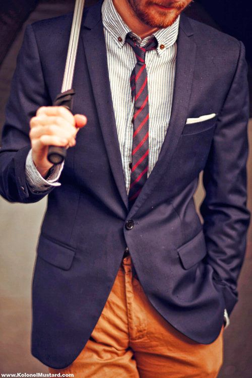 blue sport coat, orange chinos, striped tie with striped shirt