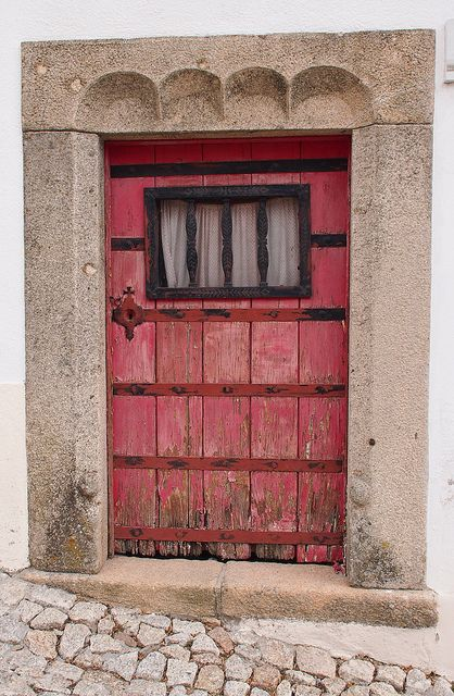 Weathered red door. Portugal
