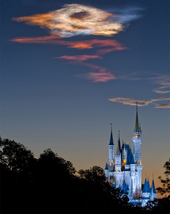 This is Cinderella's Castle at Walt Disney World in Orlando, Fla., soon after Space Shuttle Discovery launched in the early hours of Monday morning to begin its mission to the International Space Station (ISS). Located over 60 miles away, a picture of the shuttle's exhaust trail as it caught the early morning sunrise - even the clouds are magical at WDW