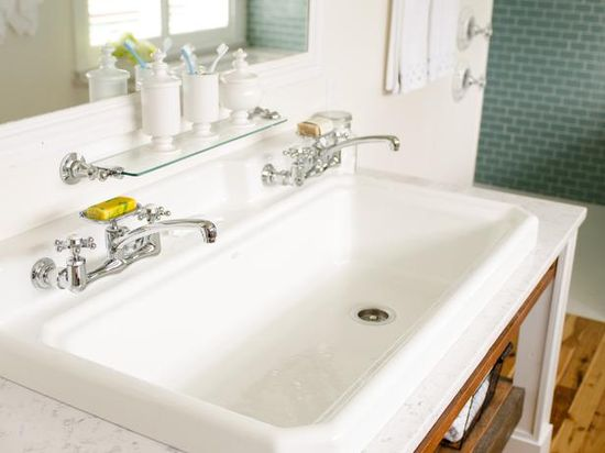 One large bathroom sink and 2 faucets