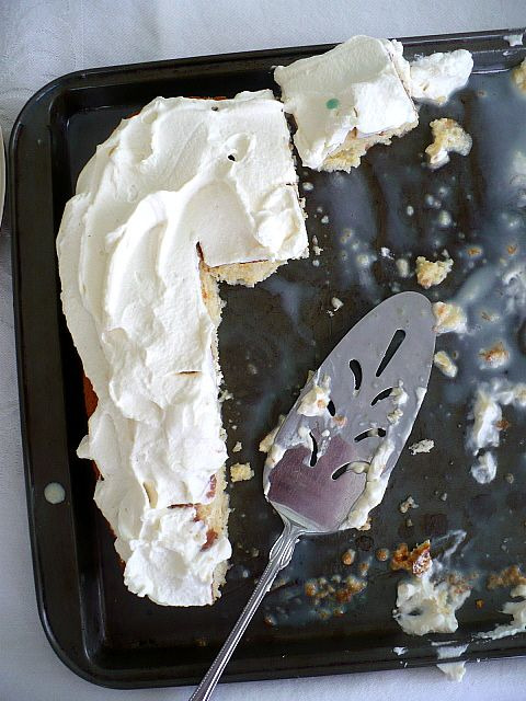 Sponge cake soaked with a mixture of condensed milk, evaporated milk, and cream and topped with mounds of billowy whipped cream.