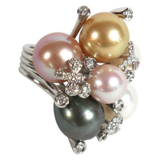 Multicolor natural pearl & diamond ring,   Italy, 1970s / Multicolor natural pearls set with diamonds and rubies in platinum. Two diamond butterflies accent the pearl cluster.