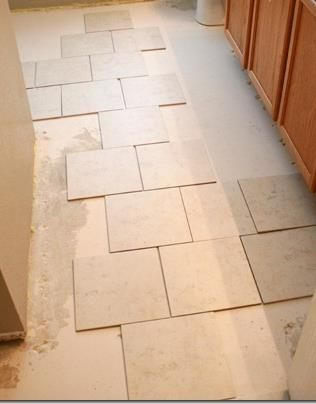 tips for installing a tile floor from Remodelaholic.com #tile #flooring #tips @Remodelaholic .com .com .com