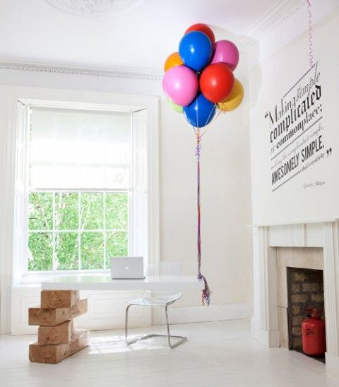 hot air balloon desk ( real, helium/hydrogen-filled balloons ) - This reception desk at the Dublin-based ad agency Boys and Girls is held aloft by balloons that are made to remain permanently inflated.