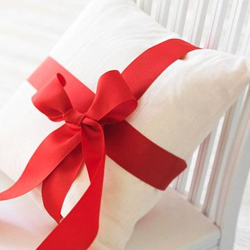 For an instant holiday touch, wrap pillows with wide ribbon.