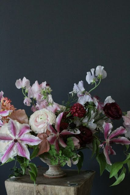 Sweet pea, clematis, ranunculus, and scabiosa centerpiece by Sarah Winward