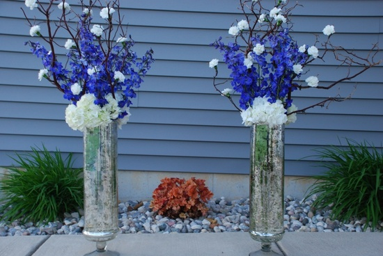 Blue and White Flower Arrangements with silver vases