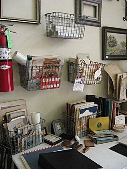 Home office. Small wire baskets for wall storage
