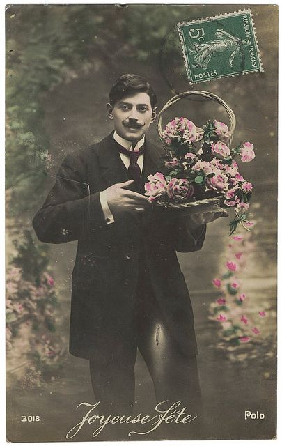 Vintage French Romantic Valentine Postcard. Lover with flowers. c 1910