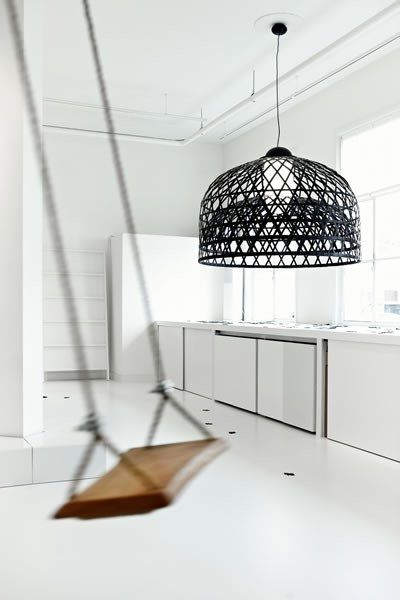 White kitchen with amazing black light fitting