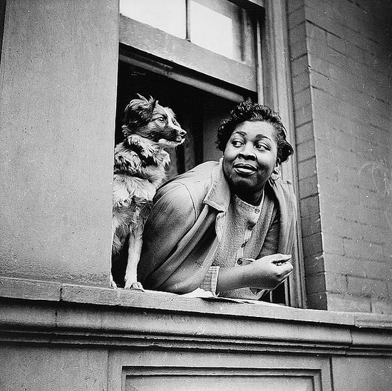 A woman and her dog, Harlem.