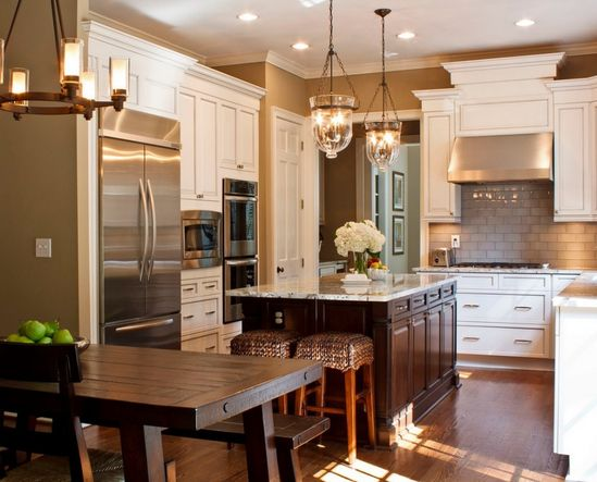 medium sized kitchen, white cabinets, dark color kitchen island, subway tile, kitchen hardwood floor