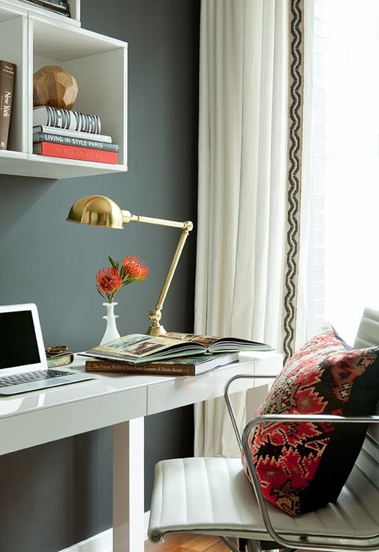 Home office by Jenny Wolf with grey walls, wallpapered ceiling, a white desk and white office chair