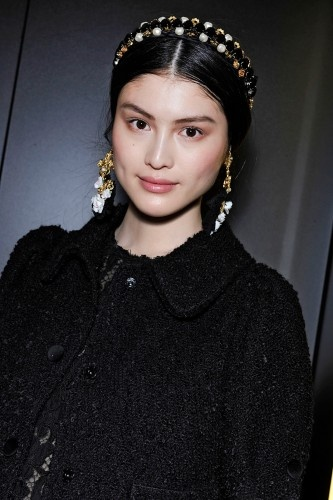 New Ways To Wear Pins, Barrettes, & More: The Jeweled Headband - Dolce & Gabbana was on to something, sending models down the runway sporting gold- and pearl-embossed headbands on top of classic, middle parted hair. The look was unmistakably glam while still being approachable and easy. Take a hint from the Italian duo and top your standard middle part with your own go-for-Baroque headband