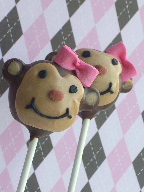 Marvelously cute little pink bow adorned Monkey Cake Pops. #pink #monkey #food #baking #dessert #cake #pops