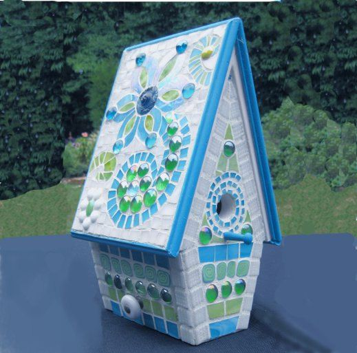 Beautiful mosaic birdhouse.
