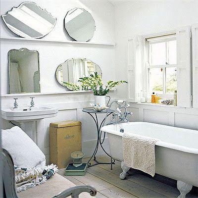 roll top bath & vintage mirrors