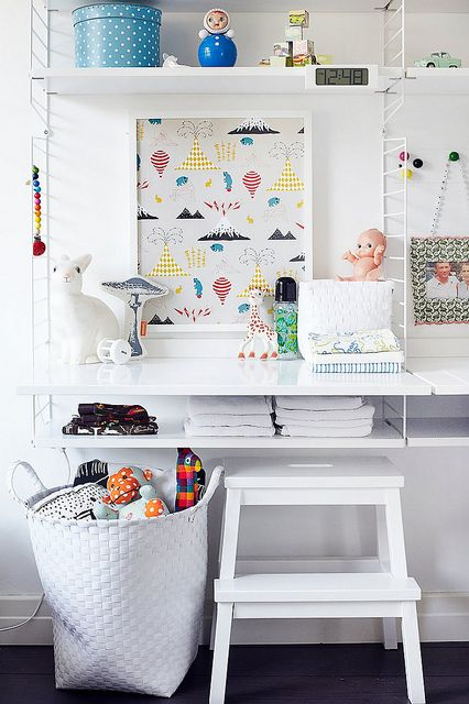 Beautiful workspace for kids. String shelves.