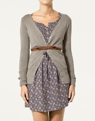 Printed dress, grey knit cardigan, and a skinny brown belt.