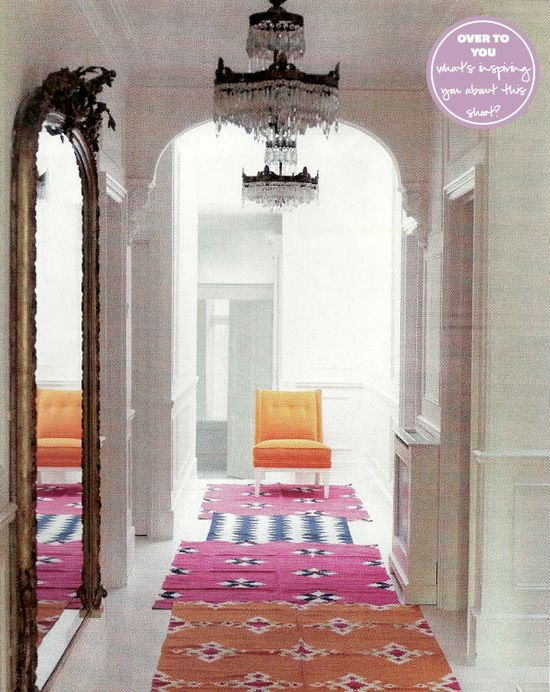 multiple rugs down a narrow hallway (via Red mag)
