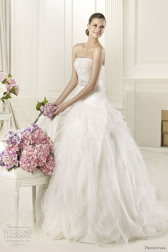 Wedding dresses 2013  Dropped waist ball gown with ruffled skirt.