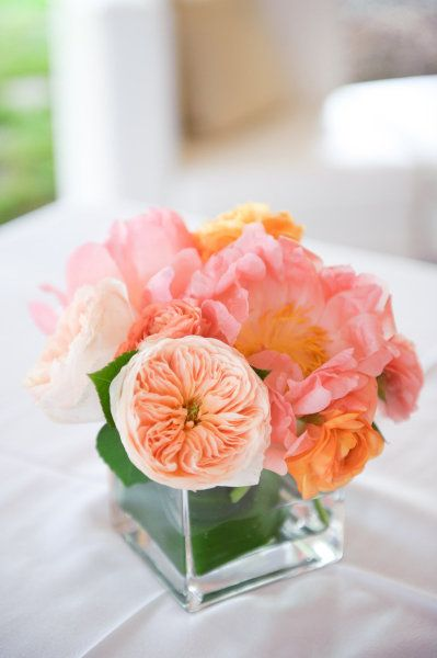 Good colors.  Simple and small arrangement for bathroom, bar, etc.  Like the left wrapped in the vase to cover stems.