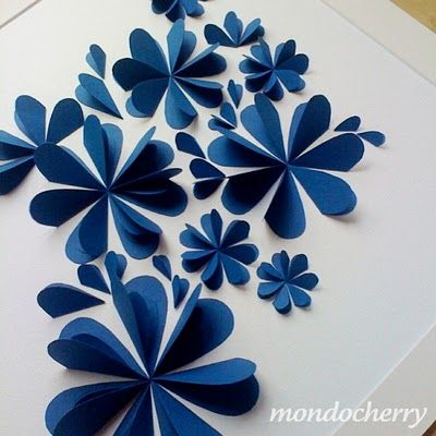 hearts folded in half with one side taped down in a circular pattern. Cute on wrapping paper for a gift or a card
