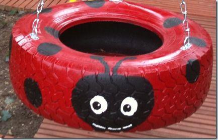 ladybug-painted tire swing.