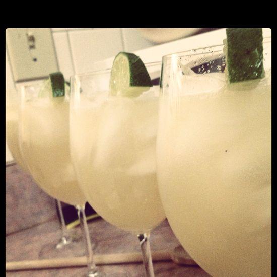 Can of frozen limeade, 12 oz. tequilla, 24 oz. Sprite, one Corona Light.   Best. Margarita. Ever.