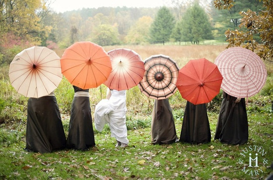 """This vintage inspired wedding happend while guest were getting rained on but it was so cute!Love the Bella Umbrellas ? """"For it is always true that the earth shines a little brighter after the rain."""""""