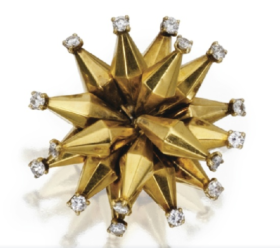 A gold and diamond starburst brooch by Cartier, France, circa 1940. [Weird, funky retro again!]