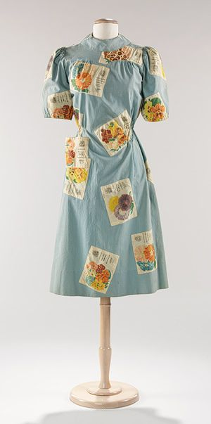 A charmingly lovely Elsa Schiaparelli flower-seed packet applique (one of which functions as a pocket) covered dress, c. 1940. #vintage #1940s #fashion
