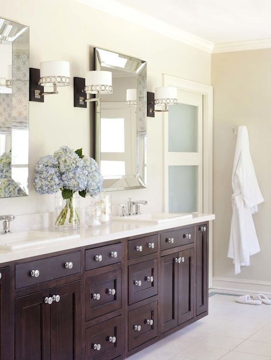 bathrooms - Sherwin Williams - Wool Skein - Pottery Barn Beveled Mirror Stonegate Designs Astoria Sconce tan walls espresso bathroom double vanity cabinets silestone quartz countertops double sinks tan walls frosted glass door / His & hers mirrors and sconces ... would be a great renovation for our master bath.