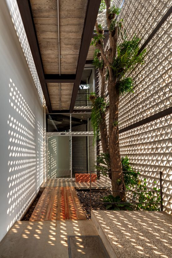 Concrete breeze blocks forming an enclosed patio with cat walk - Architectural details