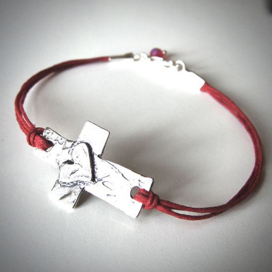 Sterling Sideways Cross...with Heart! --bracelet on red linen by JewelryByMaeBee on Etsy.