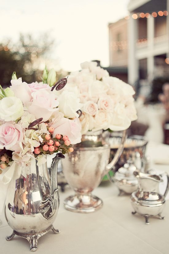 Flowers in silver pitchers/tea pots for a Silver Tea Party