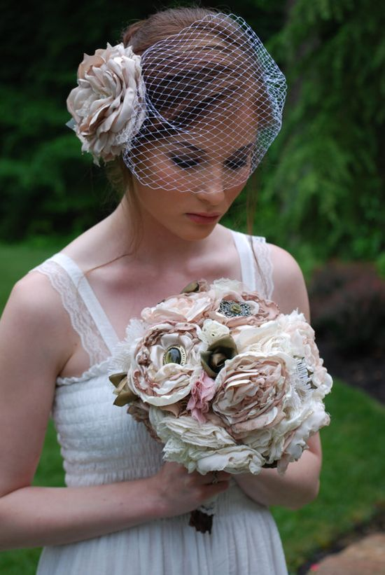 This handmade fabric flower #wedding #bouquet is made with layers of different textured fabrics and #vintage brooches! It can be customized in your colors with your own brooches or buttons, too, by Tattered Petals on Etsy. www.etsy.com/...
