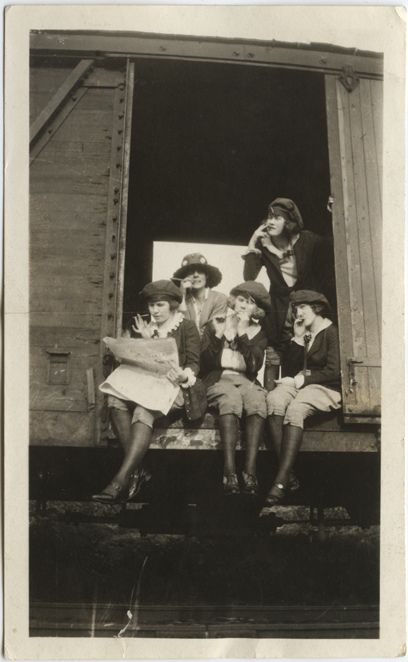 Smoking girls on a train car